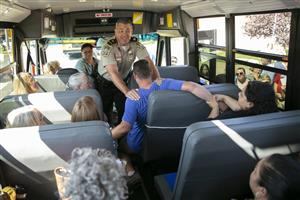 Stafford Sheriff's Office Capt. David Stoudt and recruit Don Earp show school bus drivers hot to subdue an intruder.