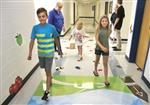 Conway students Jonah Truslow, Avery Blankenship and her older sister, Shelby, try out the school's new 'activity hall.'