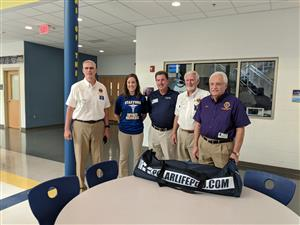 Members of the Aquia Harbour Hosts Lions Club deliver a Polar Life Pod cooling device to Stafford High School.