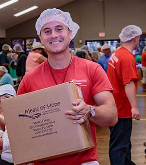 man with meals of hope box