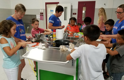Students and Staff Cooking