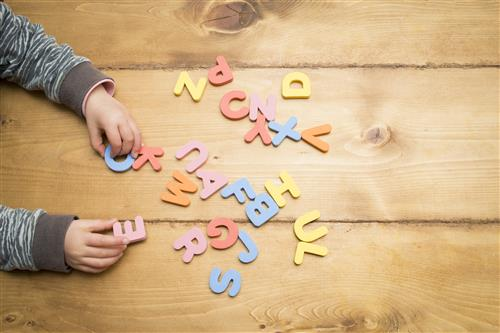 child playing with alphabet