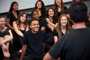 students dressed in black in drama class