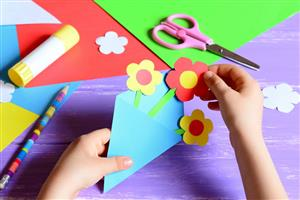 Kids making crafts with paper
