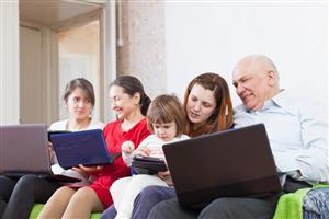 family on laptops