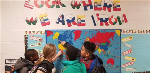 Students talk about places on the map.
